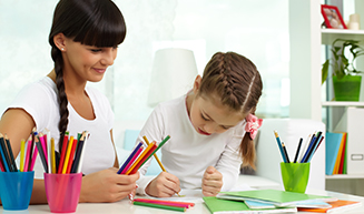 Student Drawing with Teacher